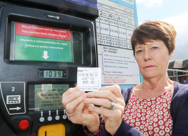 A woman has been fined for displaying her valid car parking ticket