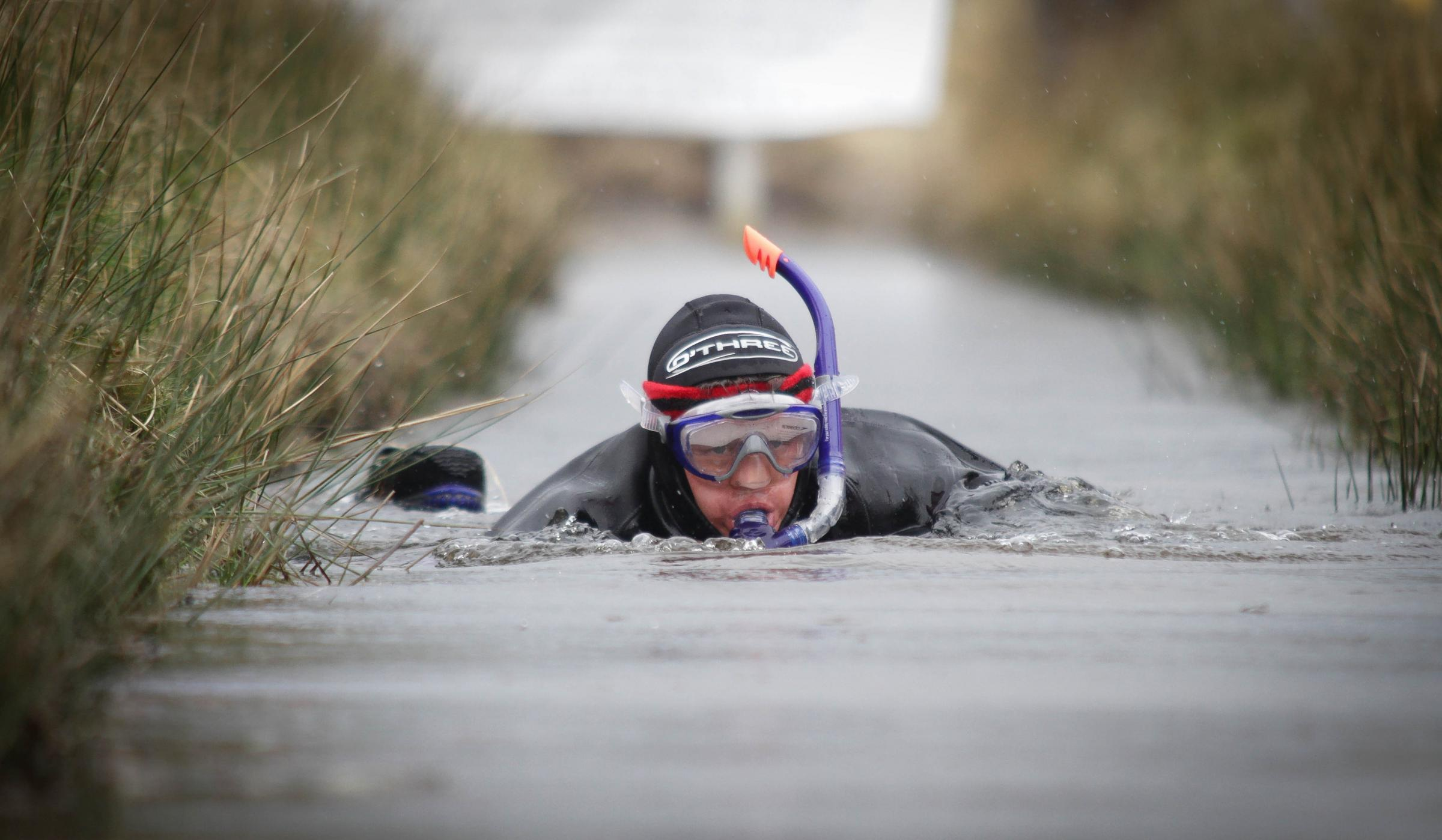 BBC Breakfast presenter, Mike Bushell goes bog-snorkelling to raise money for Sport Relief...Pic is. Mike Bushell in action...RD110_2014-15.