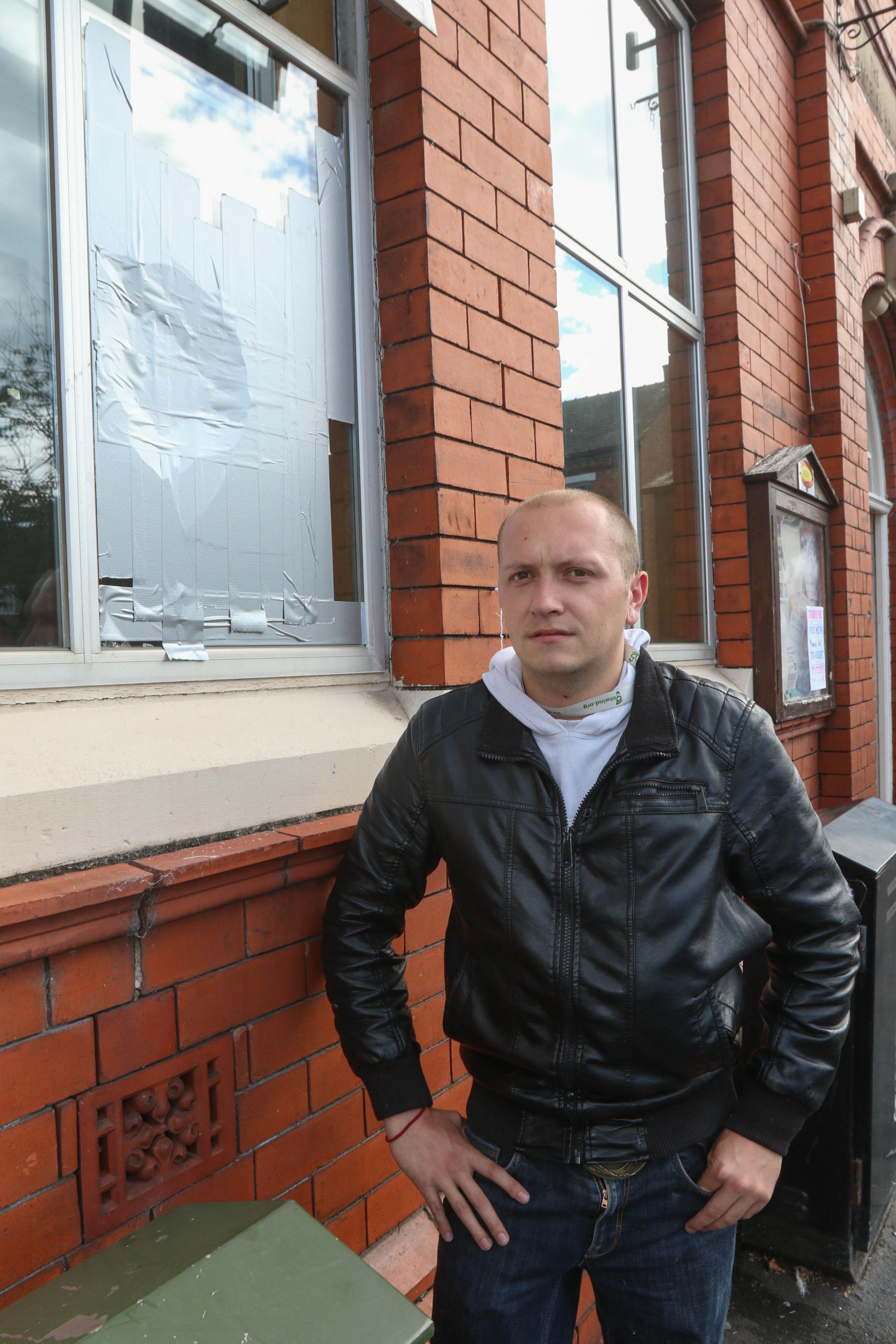 Gareth Thomas in front of broken window at The Memorial Hall Oswestry..cc060918D.