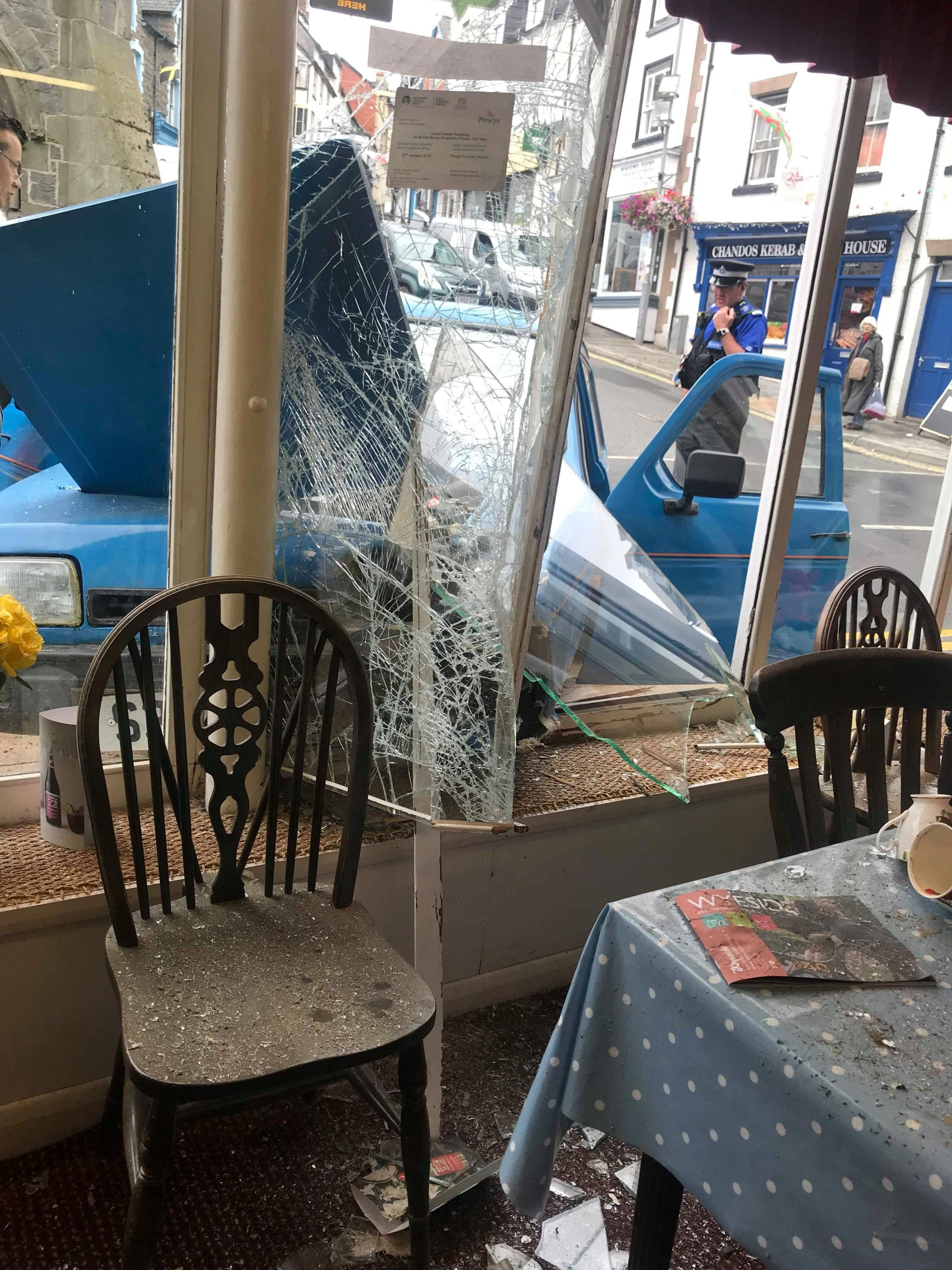 The damage caused to the Clock Tower Tea Shop in Knighton after a car struck the window.