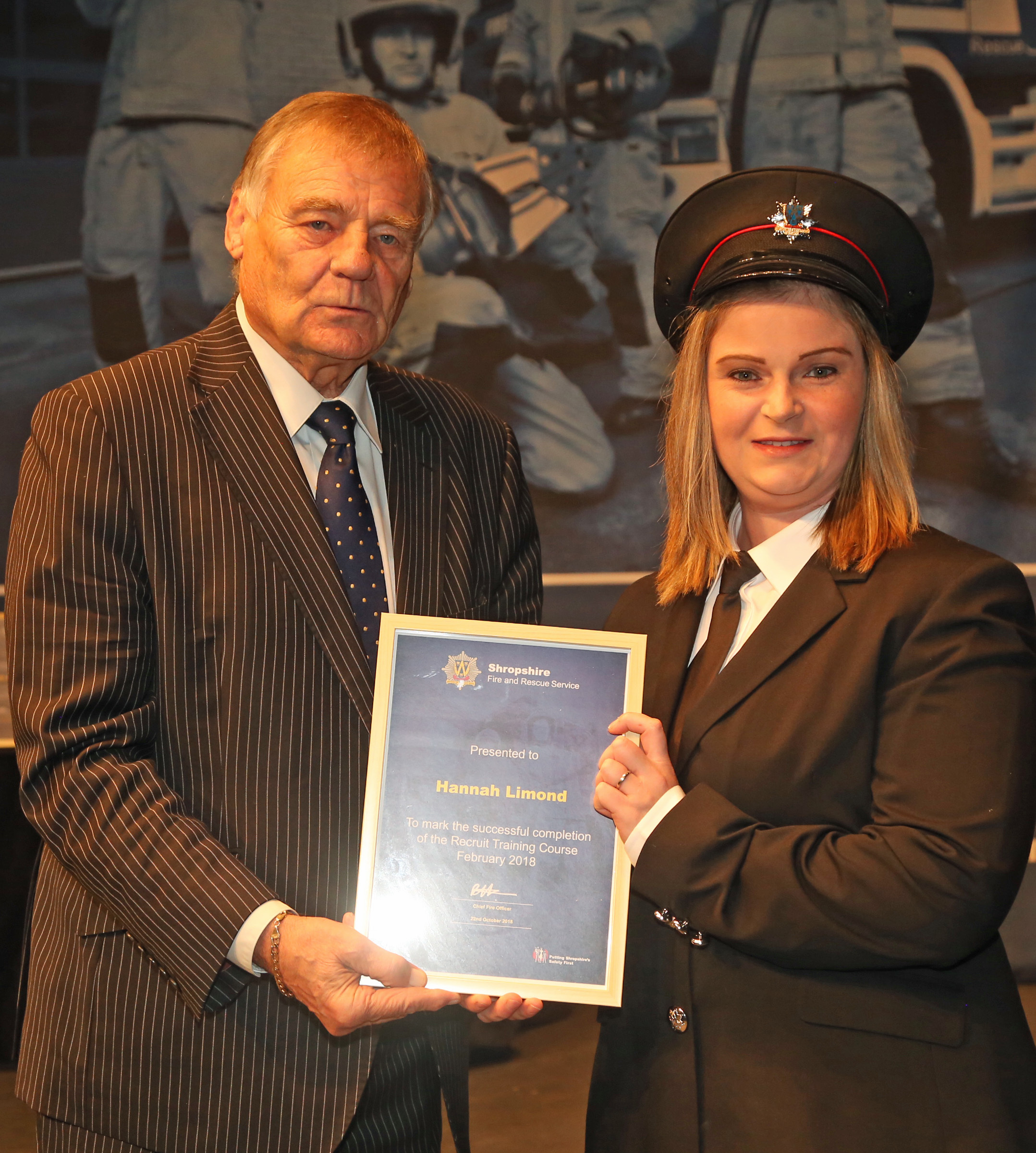 HANNAH is pictured receiving her certificate from Councillor Eric Carter, chairman of the Shropshire and Wrekin Fire Authority.