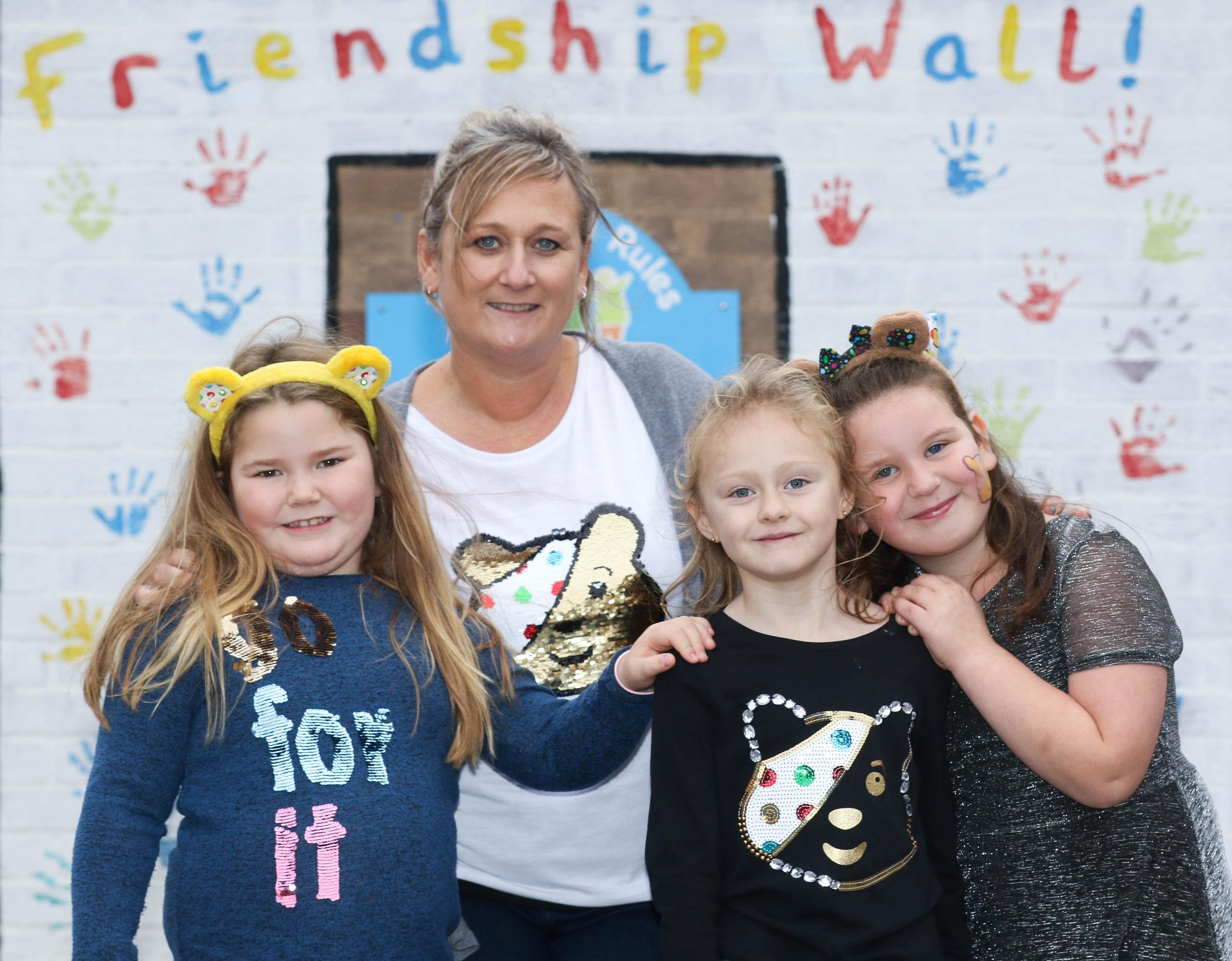 Churchstoke Primary School pupils have been dressing up for the day and raising money for Children in Need Day last Friday 16th November 2018..pictured from left to right, Brooke Pritchard (6) Sue Richards, Libby Atkins (7) and Olivia Williams (6).Picture