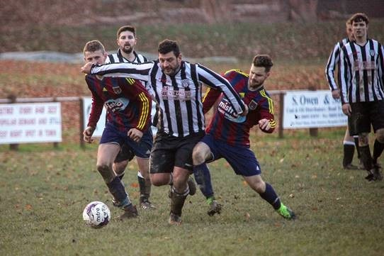 Action from Llanfyllin Town's clash with Llangedwyn. Picture by Beed Images.