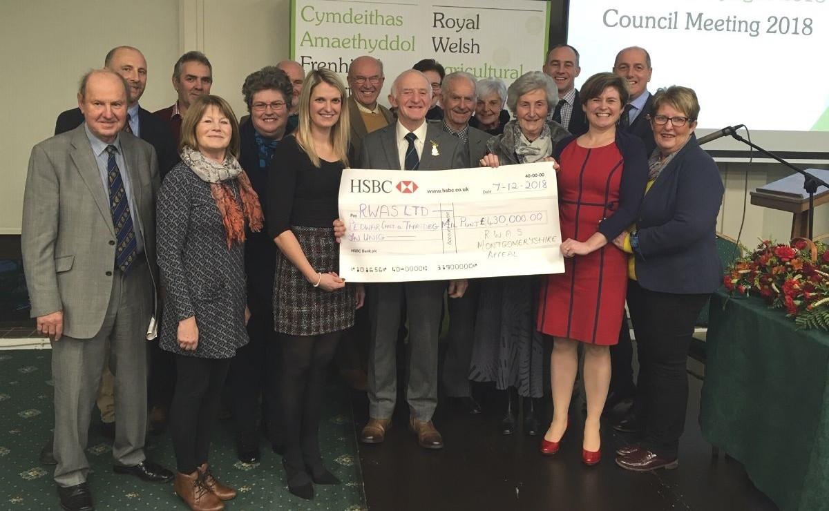 The Montgomeryshire team presenting their final cheque at the RWAS Council meeting.
