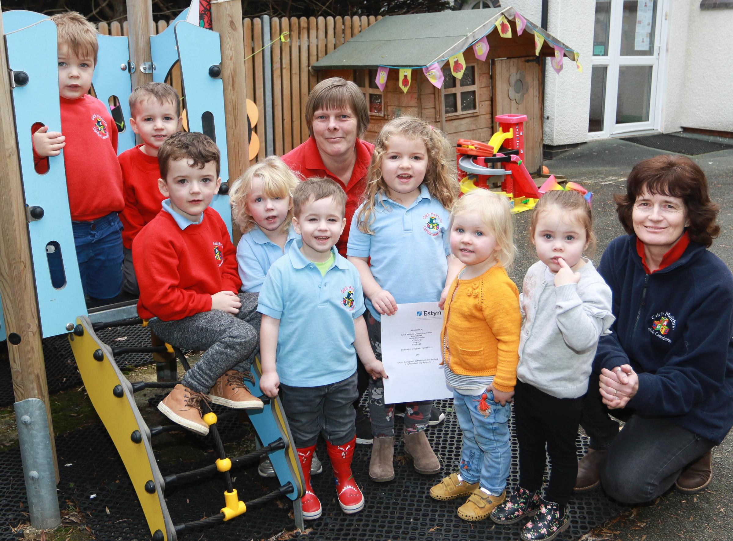 Llanfair Caereinion Nursery Cylch Meithrin has had a 'Good' Estyn report. Some of the children from the nursery are with Ellen Davies (back left) and Karen Junor (back right). Picture: Phil Blagg (PB016-4)