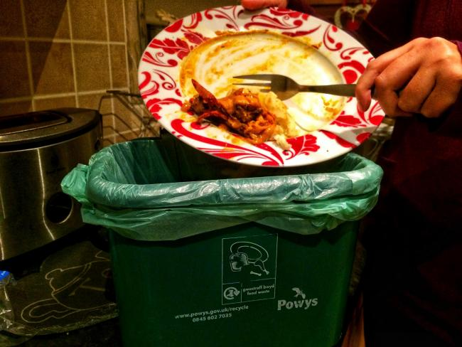 Mid Powys households are being urged to recycle more food waste.