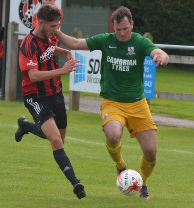 Curtis Weetman (left) in action for Guilsfield.