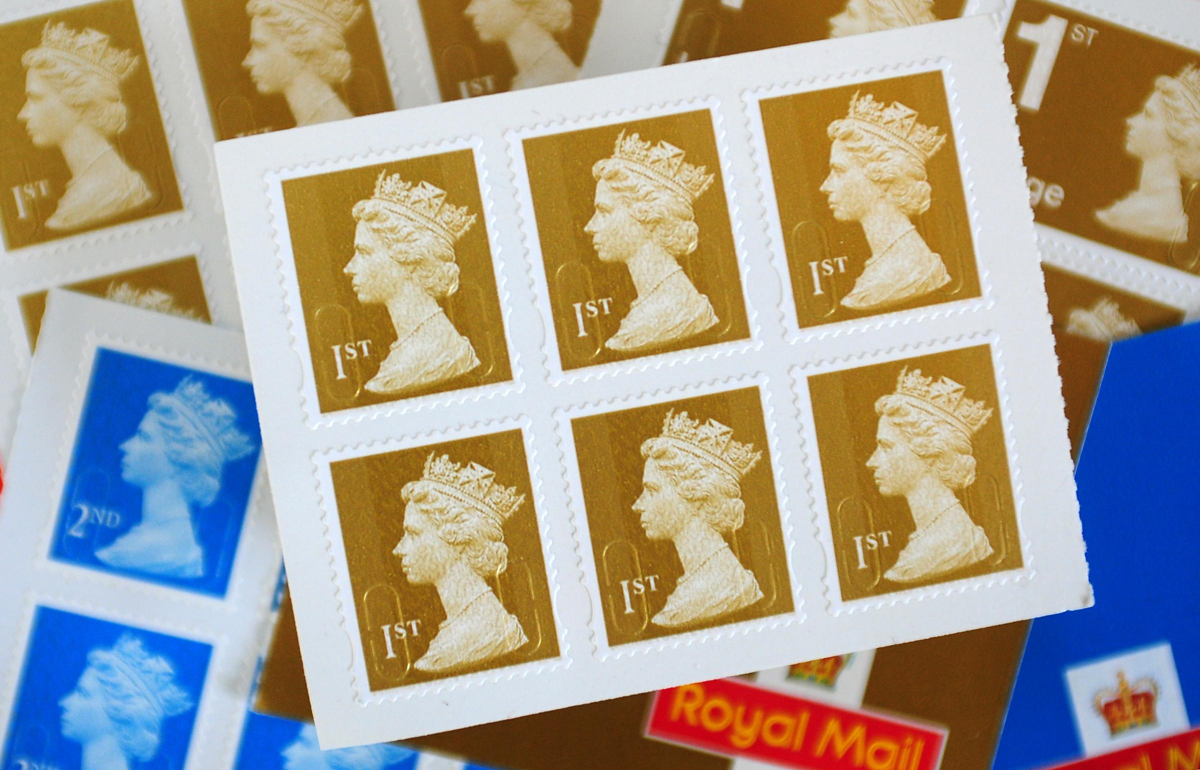 File photo dated 27/03/12of first and second-class stamps at a Post Office in Overseal, Derbyshire, as the Royal Mail announced that first-class stamp prices will increase from 67p to 70p and second class from 58p to 61p from March 25. PRESS ASSOCIATION