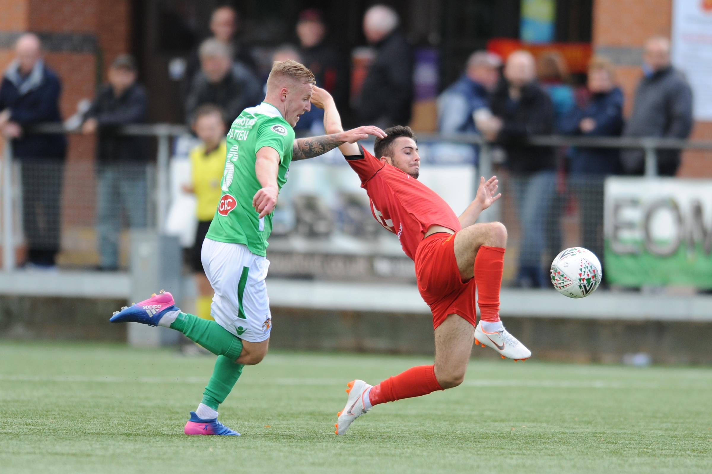6/10/2018 - Sam Phillips of Newtown stretches for a loose ball during the JD Welsh Premier fixture between Newtown AFC and Barry Town United at Latham Park...Pic: Mike Sheridan/County Times.MS230-2018.