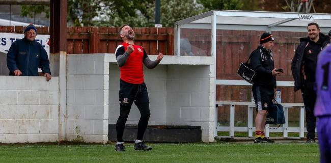 Penrhyncoch manager Gari Lewis celebrates his side's victory over Conwy Borough. Picture by Colin Ewart.