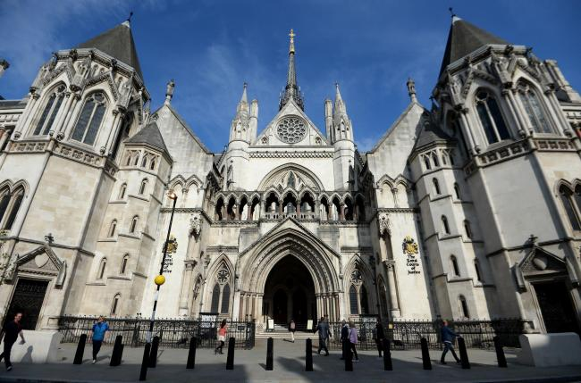 File photo of the Royal Courts of Justice in London. Photo: Andrew Matthews/PA Wire.