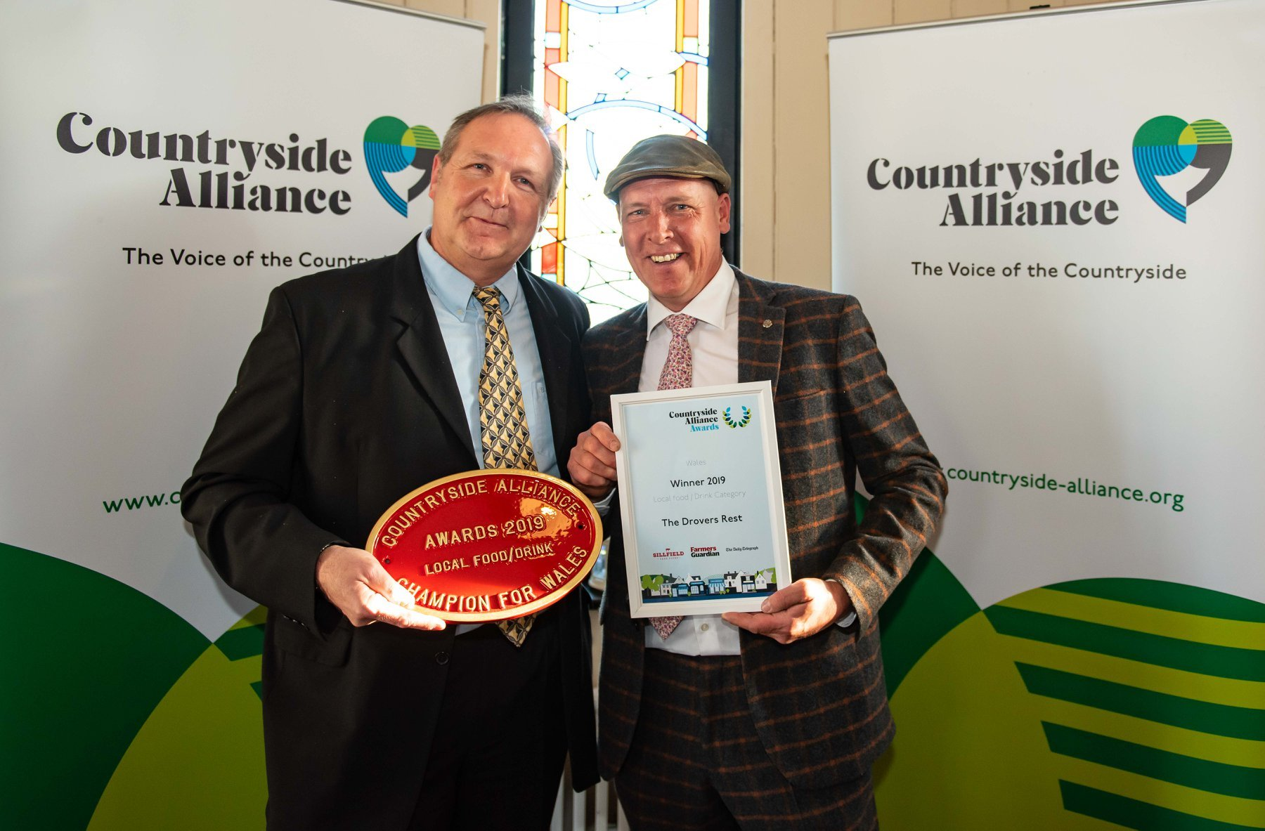 Peter James (left) of The Drovers Rest, Llanwrtyd Wells, collects his award from Gareth Wyn Jones for Best Local Food and Drink. Picture: Peter Anderson, Anderson Photography