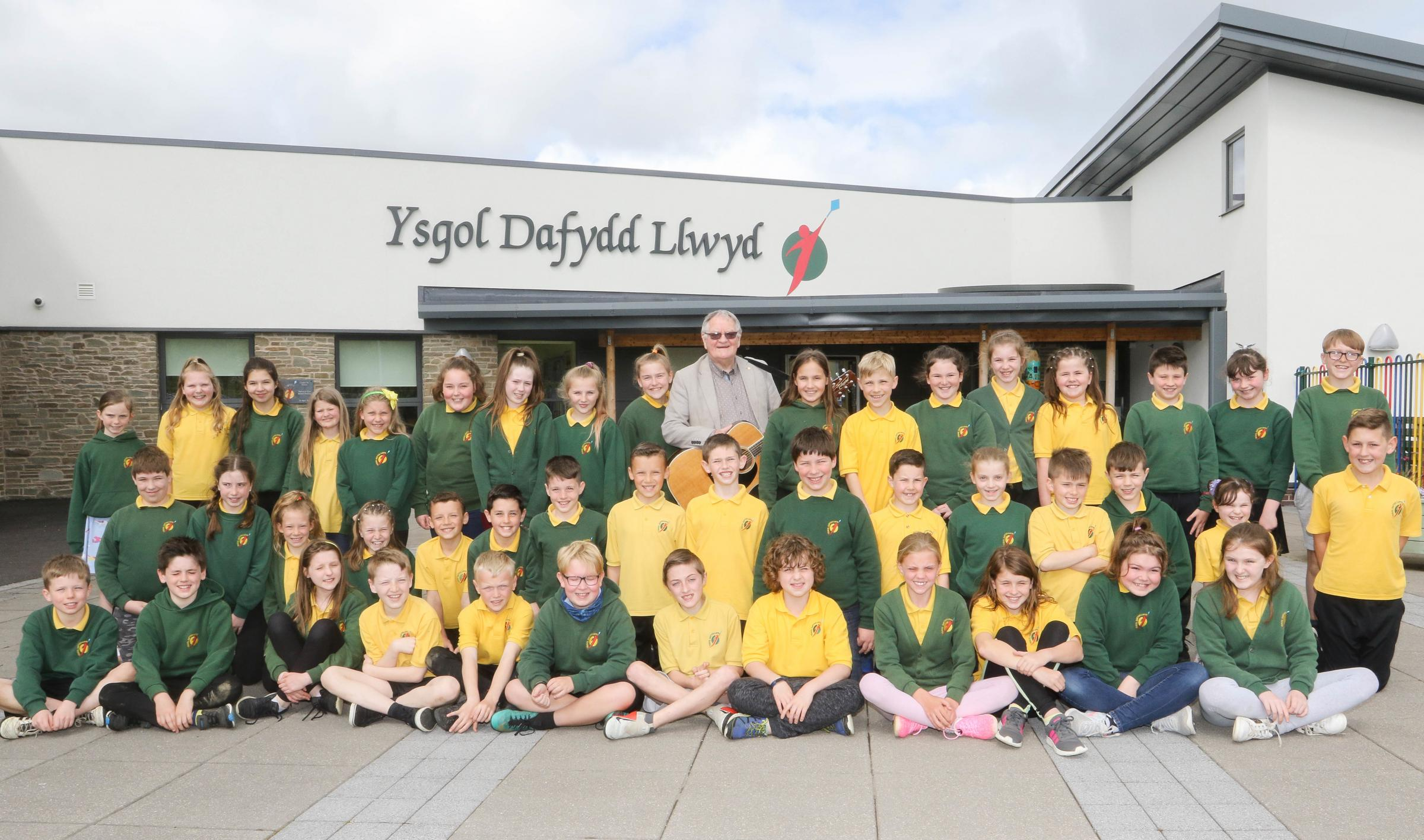 Welsh political and cultural legend Dafydd Iwan visited  Ysgol Dafydd Llwyd, Newtown last Thursday 2nd May 2019..He sang songs to the children, staff and community..Picture by Phil Blagg..PB203-2019-1.