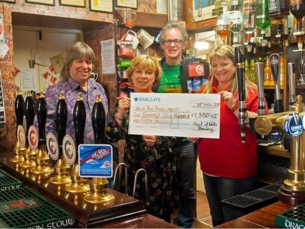 Left: Heart of Wales brewer Lindsay Ketteringham, his wife Catherine, resident John Crompton, and Wales Air Ambulance representative Tina Ford with the cheque for £1,350 at the Neuadd Arms Hotel, Llanwrtyd Wells. Photo: Martin Pigott