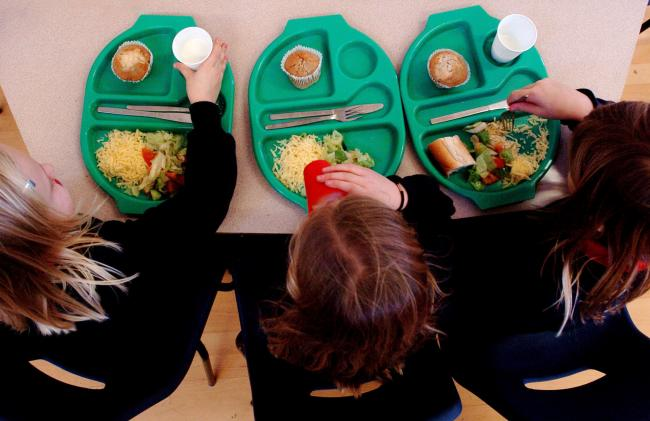 A generic picture of pupils enjoying school dinner. Pic: PA.