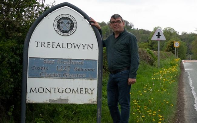 Simon Bedford with one of the signs on the road entrances to Montgomery. Picture: G17 Photography Services